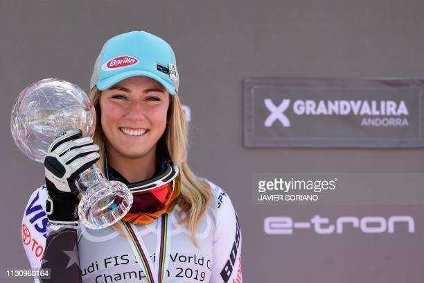 Winner of the overall FIS Alpine ski slalom US Mikaela Shiffrin celebrates with the crystal globe trophy during the podium ceremony after competing...