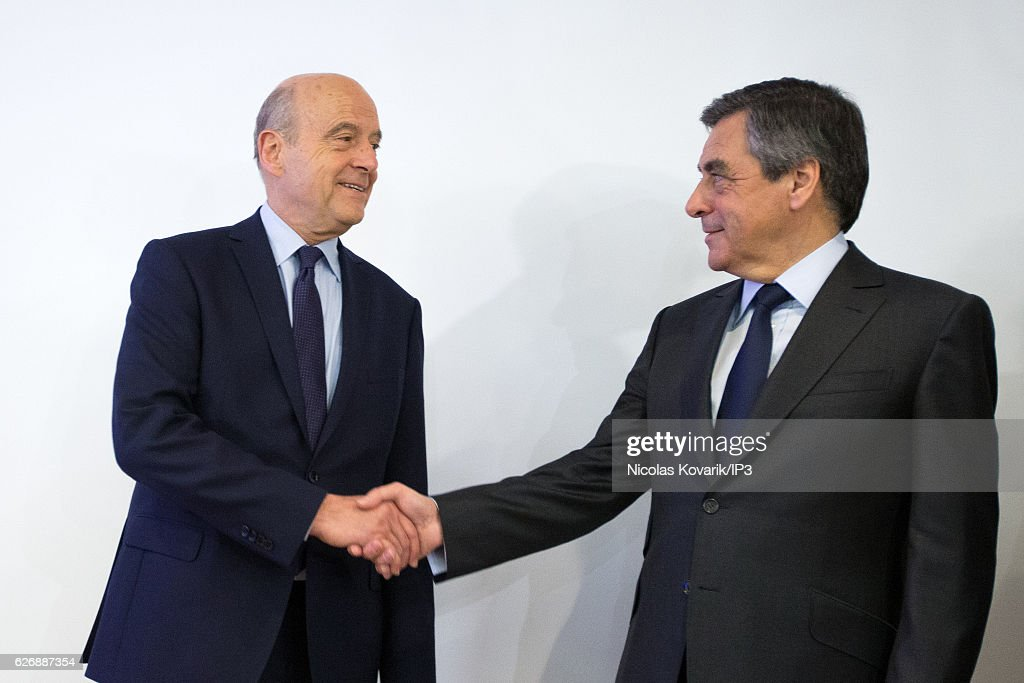 Winner of the Primary Election of the right wing Les Republicains Francois Fillon (R) and his opponent Alain Juppe (L) exchange an handshake publicly after the announcement of the results, at the headquarters of the High Voting Authority on November 27, 2016 in Paris, France. Francois Fillon (R) won the second round of the Primary with more than 66% of the votes. He will stand as the candidate for Les Republicains in the French Presidential Election in April 2017.