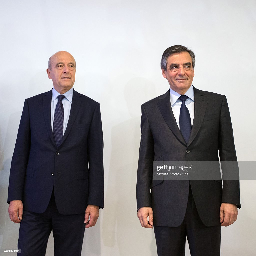 Winner of the Primary Election of the right wing Les Republicains Francois Fillon (R) meets his opponent Alain Juppe (L) to exchange with him an handshake publicly after the announcement of the results, at the headquarters of the High Voting Authority on November 27, 2016 in Paris, France. Francois Fillon (R) won the second round of the Primary with more than 66% of the votes. He will stand as the candidate for Les Republicains in the French Presidential Election in April 2017.
