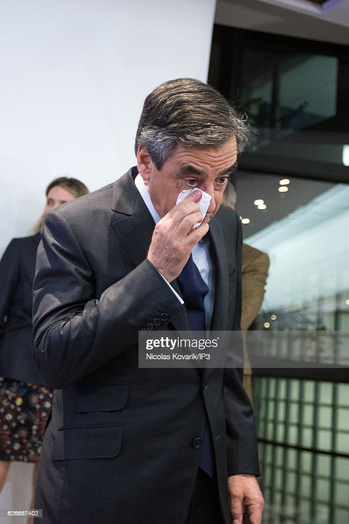Winner of the Primary Election of the right wing Les Republicains Francois Fillon reacts after a photographer, arriving at the headquarters of the High Voting Authority to exchange an handshake with his opponent Alain Juppe (not pictured) on November 27, 2016 in Paris, France. Francois Fillon won the second round of the Primary with more than 66% of the votes. He will stand as the candidate for Les Republicains in the French Presidential Election in April 2017.