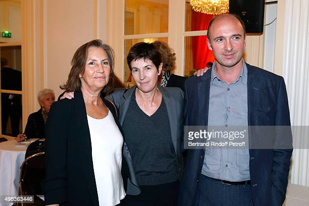 Winner of the Prize Christine Angot for her book 'Un amour impossible' standing between CEO of Flammarion Gilles Haeri and Teresa Cremisi the 'Prix...