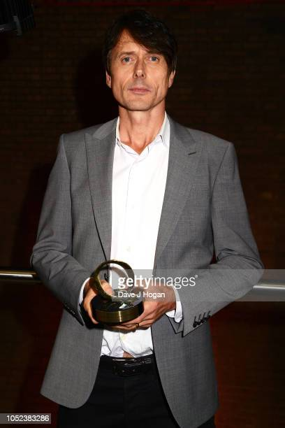 Winner of the Q Lifetime Achievement Award Presented by Honda Motorcycles Brett Anderson poses at the Q Awards 2018 held at The Roundhouse on October...