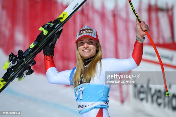 Winner of the race Switzerland's Lara GutBehrami reacts during the podium ceremony of the women's downhill at the FIS Alpine Ski World Cup in...