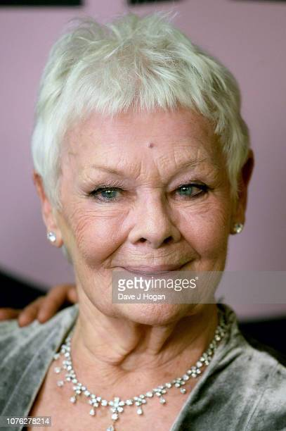 Winner of The Richard Harris Award for Outstanding Contribution by an Actor to British Film Dame Judi Dench poses in the winners room at the 21st...