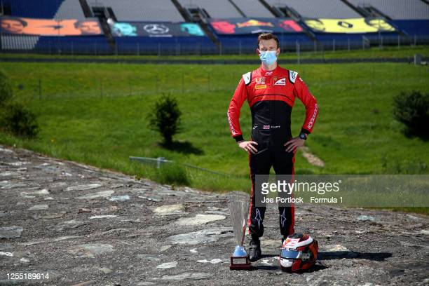 Winner of the round 1 feature race Callum Ilott of Great Britain and UNI-Virtuosi Racing poses for a photo during previews for the Formula 2...