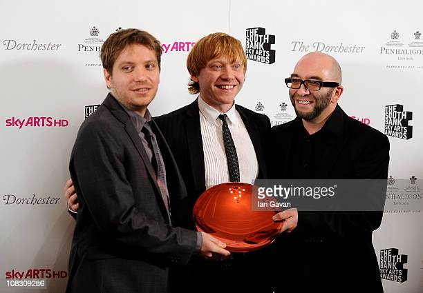 Winner of the South Bank Sky Arts Awards Film for Monsters director Gareth Edwards poses with actor Rupert Grint in the press room at the South Bank...