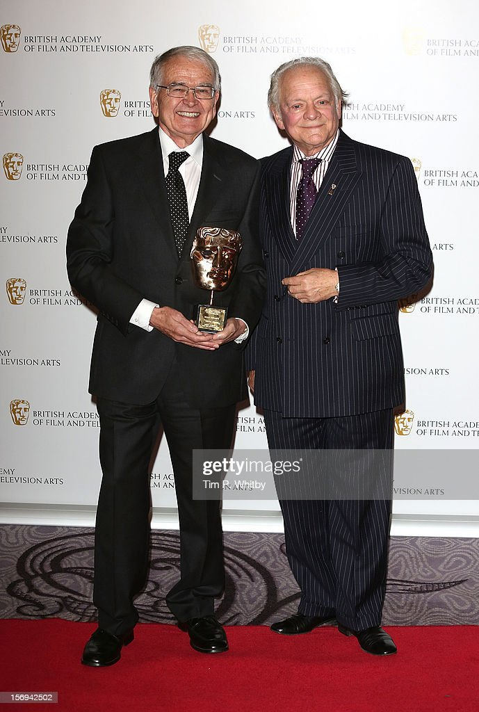 Winner of the Special Award for Outstanding Creative Contribution to the Industry Brian Cosgrove and actor David Jason pose for a photograph in the press room at the British Academy Children's Awards at London Hilton on November 25, 2012 in London, England.