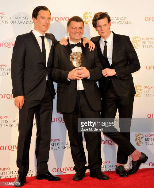 Winner of the Special Award Steven Moffat and presenters Benedict Cumberbatch and Matt Smith pose in front of the winners boards at the Arqiva...