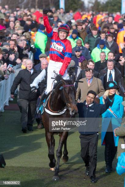 Winner of The Sportingbet Queen Mother Champion Steeplechase Sprinter Sacre ridden by Barry Geraghty is led inton the winners enclosure on the second...