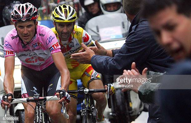 Winner of the stage, Italy's Leonardo Piepoli follows uphill the Pink Jersey, Italy's Ivan Basso during the thirteenth stage of Giro D'Italia cycling...