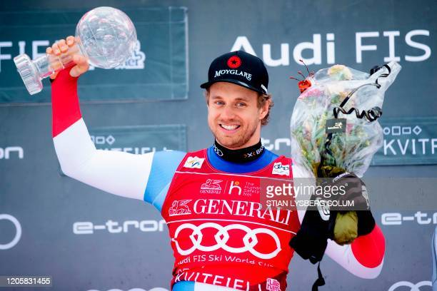 Winner of the Super-G Overall World Cup Mauro Caviezel from Switzerland poses on the podium with his Crystal Ball during an award ceremony, after the...