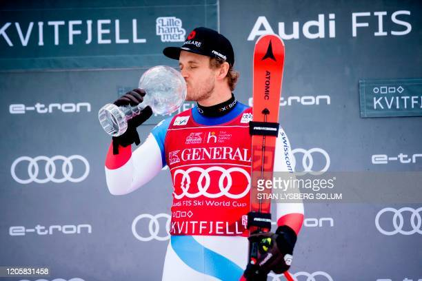 Winner of the SuperG Overall World Cup Mauro Caviezel from Switzerland poses on the podium and kisses his Crystal Ball trophy during an award...