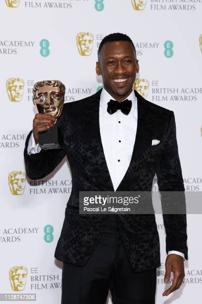 Winner of the Supporting Actor award for Green Book Mahershala Ali poses in the press room during the EE British Academy Film Awards at Royal Albert...