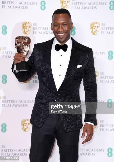 Winner of the Supporting Actor award for Green Book, Mahershala Ali poses in the press room during the EE British Academy Film Awards at Royal Albert...