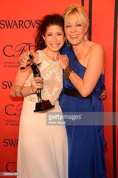 Winner of the Swarovski Accessories Designer of the Year Pamela Love poses with Nadja Swarovski at the 2013 CFDA Fashion Awards at Alice Tully Hall...