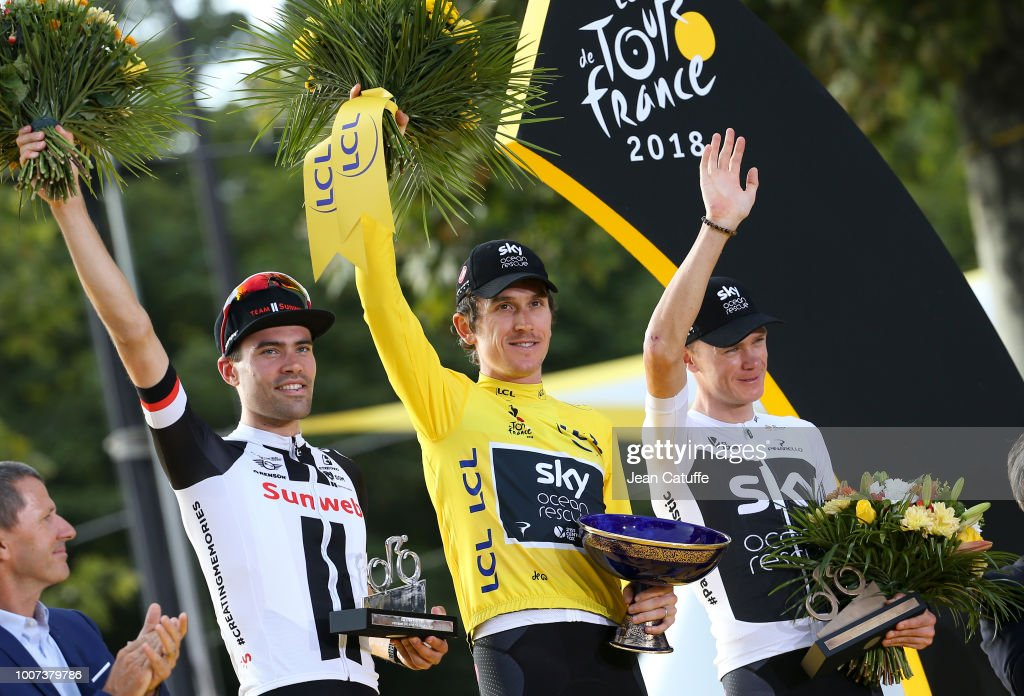 Winner of the Tour, yellow jersey Geraint Thomas of Great Britain and Team Sky surrounded by second place Tom Dumoulin of the Netherlands and Team Sunweb and third place Chris Froome of Great Britain and Team Sky during the final podium ceremony following stage 21 of Le Tour de France 2018 between Houilles and Paris - avenue des Champs-Elysees (116 km) on July 29, 2018 in Paris, France.