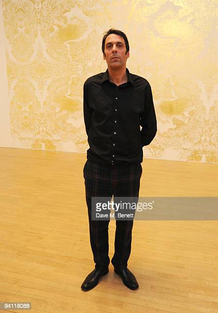 Winner of the Turner Prize 2009 Richard Wright poses in front of his art work following the Turner Prize 2009 winner announcement at Tate Britain on...