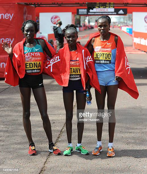 Winner of the Women's Elite Race Mary Keitany poses with second place Edna Kiplagat and third place Priscah Jeptoo at the Virgin London Marathon on...