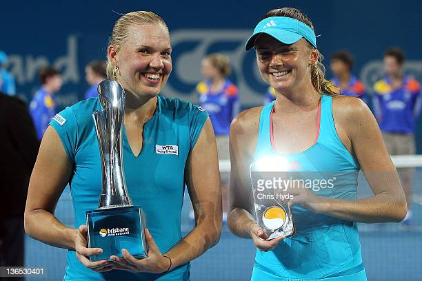 Winner of the Womens final Kaia Kanepi of Estonia holds the Yvonne Goolagong trophy and runner up Daniela Hantuchova of Slovakia pose for a...