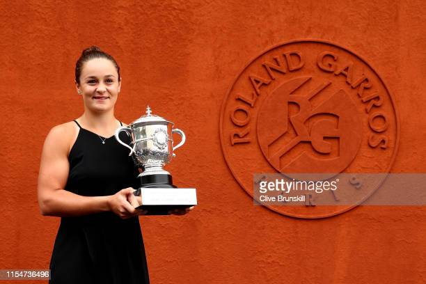 Winner of the womens singles Ashleigh Barty of Australia poses for a photo with the winners trophy during Day fifteen of the 2019 French Open at...
