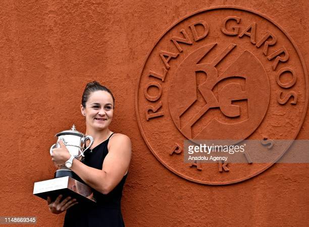 Winner of the women's singles Ashleigh Barty of Australia poses with the trophy during a photocall at the French Open tennis tournament at Roland...