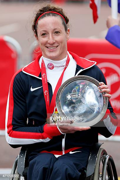 Winner of the Women's Wheelchair race Tatyana McFadden of the United States celebrates with the trophy following the Virgin Money London Marathon on...