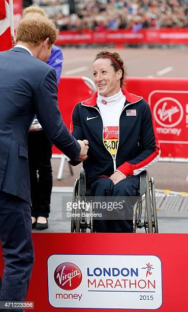 Winner of the Women's Wheelchair race Tatyana McFadden of the United States shakes hands with Prince Harry following the Virgin Money London Marathon...