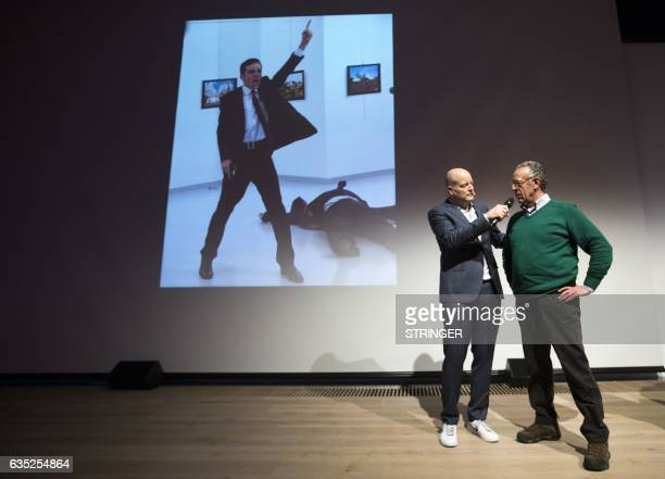 Winner of the World Press Photo 2016 photographer Burhan Ozbilici speaks next to Lars Boering managing director of the World Press Photo Foundation...
