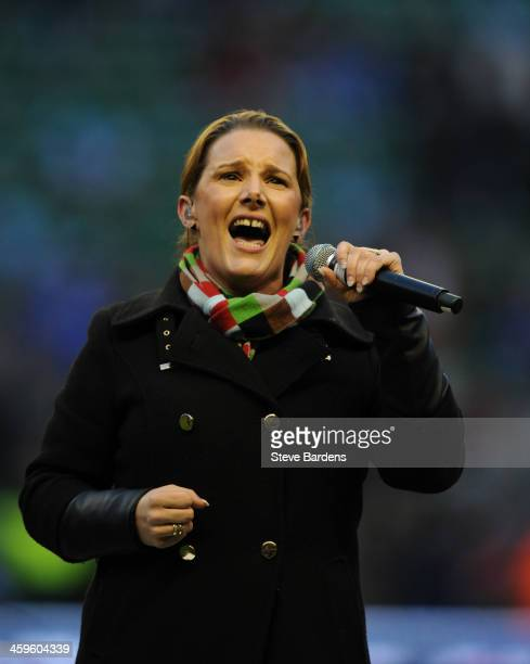 Winner of the X Factor 2013 Sam Bailey sings before the Aviva Premiership match between Harlequins and Exeter Chiefs at Twickenham Stadium on...