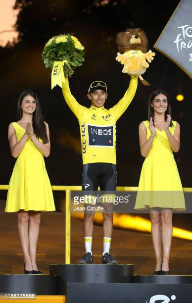 Winner of Tour de France 2019, yellow jersey Egan Bernal Gomez of Colombia and Team Ineos during the podium ceremony following stage 21 of the 106th...