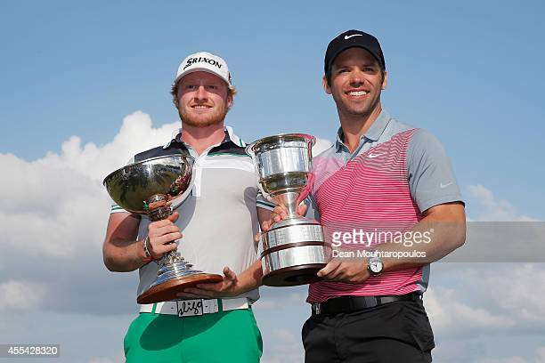Winner Paul Casey of England and highest ranked amature Jeroen Krietemeijer of the Netherlands pose with their trophies after winning the KLM Open...