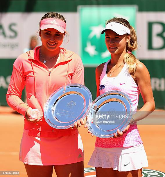 Winner Paula Badosa Gibert of Spain and runner up Anna Kalinskaya of Russia pose with their trophy after the girl's singles final match on day...