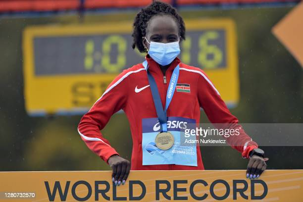 Winner Peres Jepchirchir of Kenya celebrates on the podium after the Women's Final Run during the World Athletics Half Marathon Championships on...