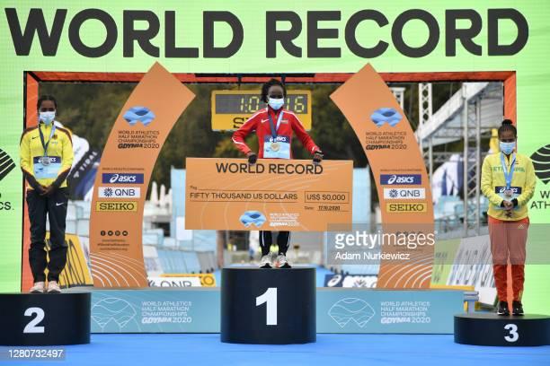 Winner Peres Jepchirchir of Kenya , second placed Melat Yisak Kejeta of Germany and third placed Yalemzerf Yehualaw of Ethiopia stand on the podium...