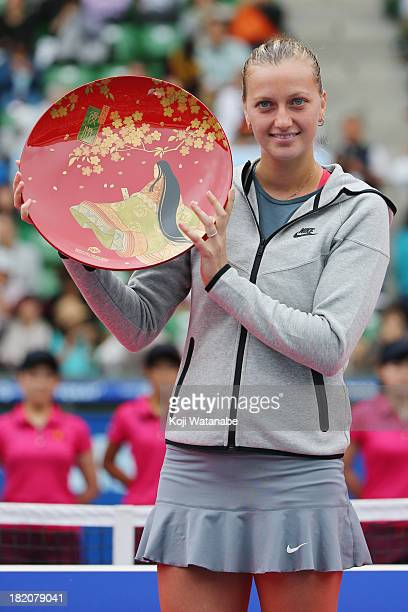Winner Petra Kvitova of Czech Republic celebrates with her plate after her women's singles final match against Angelique Kerber of Germany during day...