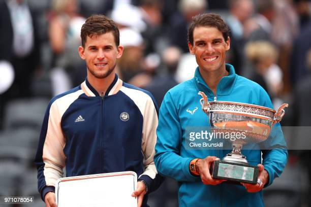 Winner Rafael Nadal of Spain and runner up Dominic Thiem of Austria pose with their trophies following the mens singles final during day fifteen of...