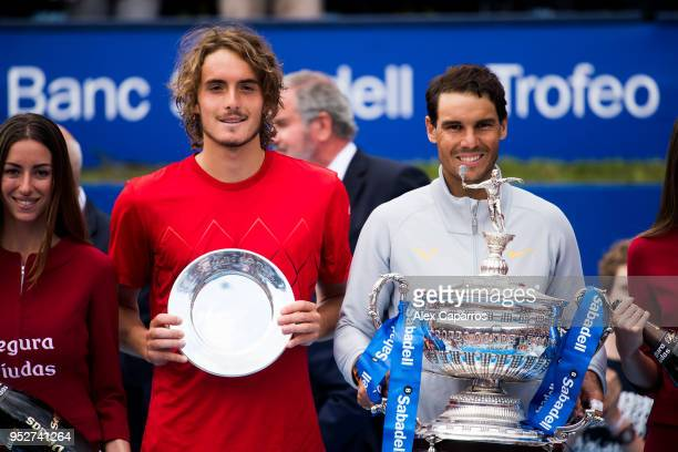 Winner Rafael Nadal of Spain and Stefanos Tsitsipas of Greece pose with their trophies after their final match during day seven of the Barcelona Open...