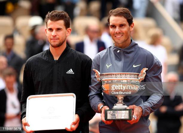 Winner, Rafael Nadal of Spain stands next to runner up Dominic Thiem of Austria with their trophies following their mens singles final during Day...