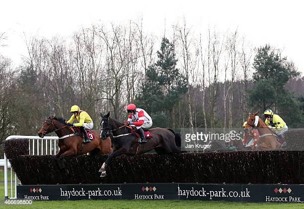 Winner Red Admirable ridden by Charlie Poste jumps the first Blenheim Brook in The ApolloBet Best Odds Guaranteed Handicap Steeple Chase during Irish...