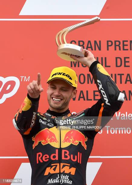 Winner Red Bull KTM Ajo's rider Brad Binder celebrates with the trophy on the podium after the Moto2 race of the MotoGP Valencia Grand Prix at the...