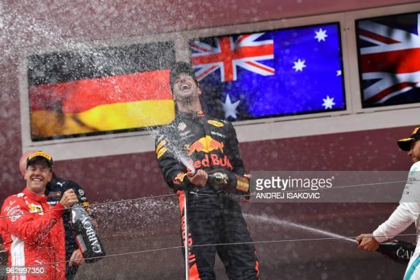TOPSHOT Winner Red Bull Racing's Australian driver Daniel Ricciardo secondplaced Ferrari's German driver Sebastian Vettel and thirdplaced Mercedes'...