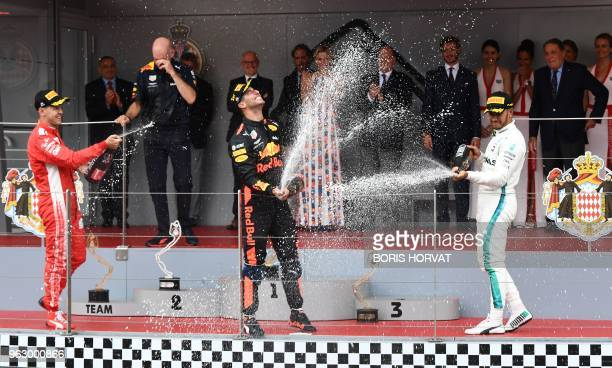 Winner Red Bull Racing's Australian driver Daniel Ricciardo secondplaced Ferrari's German driver Sebastian Vettel and thirdplaced Mercedes' British...