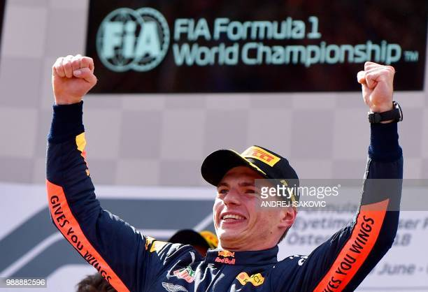 Winner Red Bull's Dutch driver Max Verstappen celebrates on the podium after winning the Austrian Formula One Grand Prix in Spielberg central Austria...