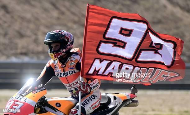 Winner Repsol Honda Team's Spanish rider Marc Marquez celebrates after the MOTO GP race of the Moto Grand Prix of Aragon at the Motorland circuit in...
