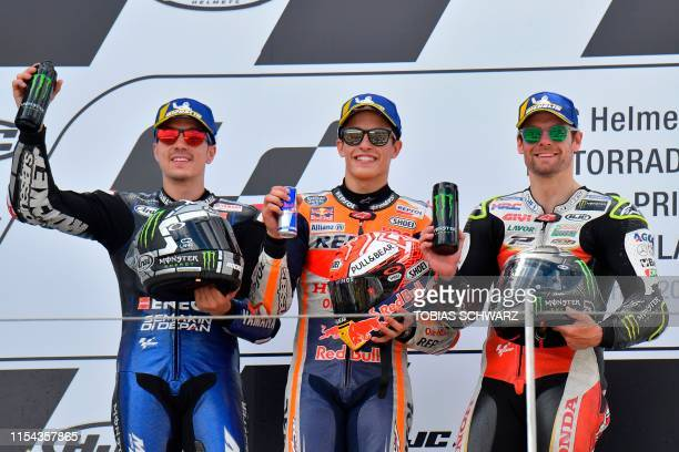 Winner Repsol Honda Team's Spanish rider Marc Marquez second placed Monster Energy Yamaha' Spanish rider Maverick Vinales and third placed LCR...