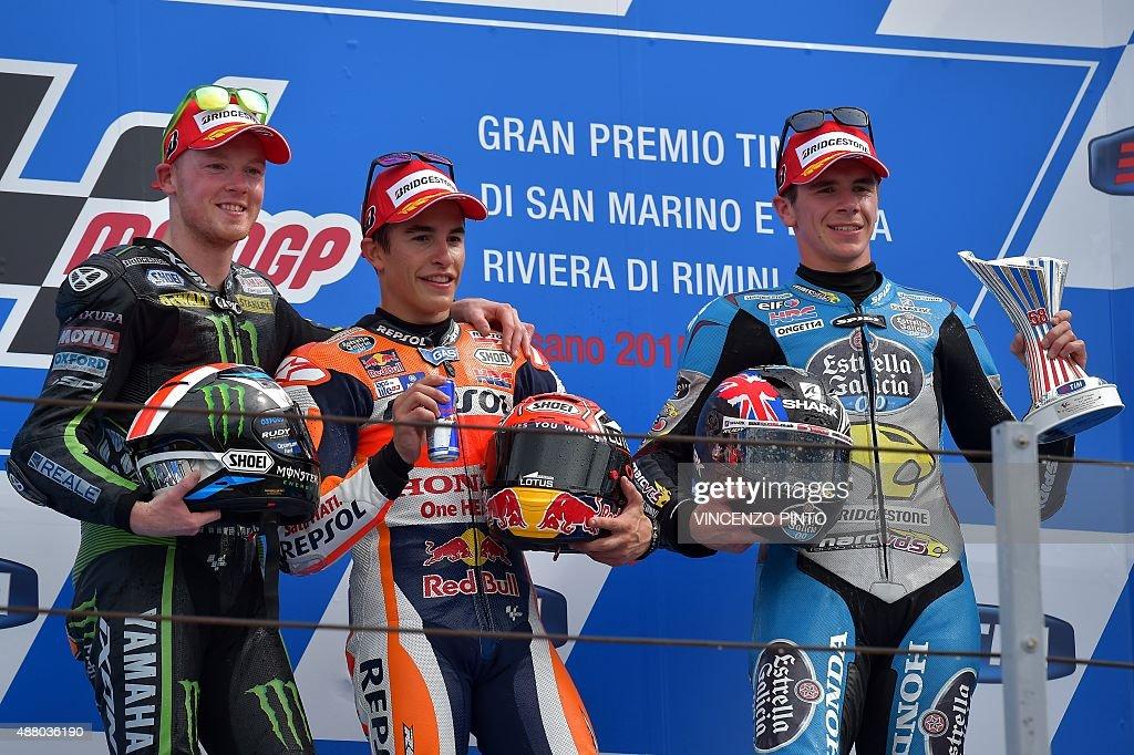 Winner Repsol Honda Team's Spanish rider Marc Marquez (C), second-placed Monster Yamaha Tech 3's British Bradley Smith (L) and GO&FUN Honda Gresini's British rider Scott Redding pose on the podium of the Moto GP race of the San Marino MotoGP, in Misano Adriatico on September 13, 2015.