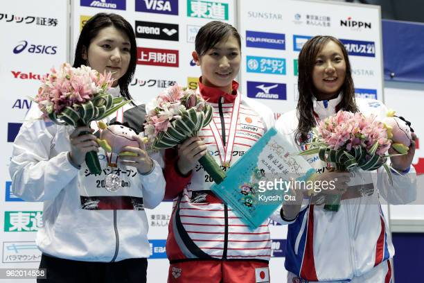 Winner Rikako Ikee of Japan celebrates with runnerup Yukina Hirayama of Japan and thirdplaced Ai Soma of Japan after the Women's 50m Butterfly final...