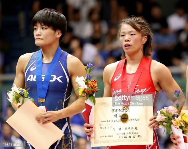 Winner Risako Kawai and runnerup Kaori Icho attend the award ceremony for the Women's 57kg on day four of the All Japan Wrestling Invitational...