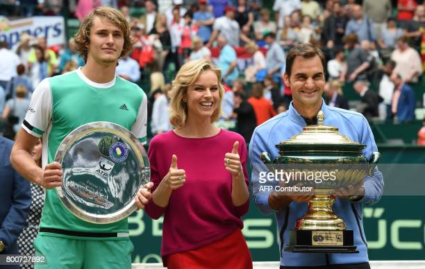 Winner Roger Federer from Switzerland and second placed Alexander Zverev from Germany pose with Czech model Eva Herzigova after the final of the...