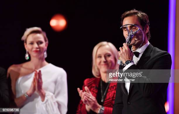 Winner Roger Federer kisses the Laureus World Sportsman of the Year 2018 award during the 2018 Laureus World Sports Awards show at Salle des Etoiles...